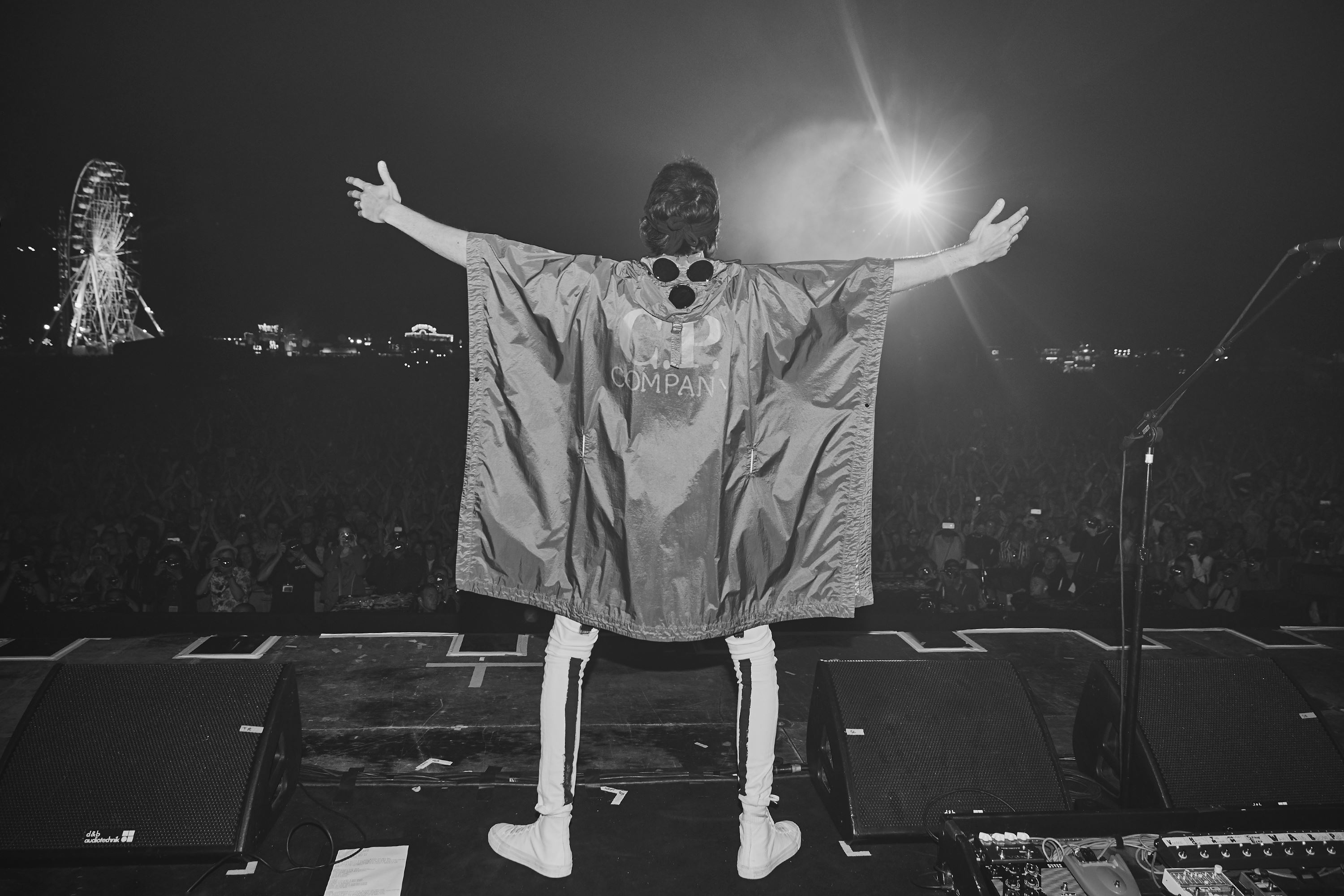 Sergio Pizzorno wears a customised C.P. Company poncho at Isle of Wight Festival 2018
